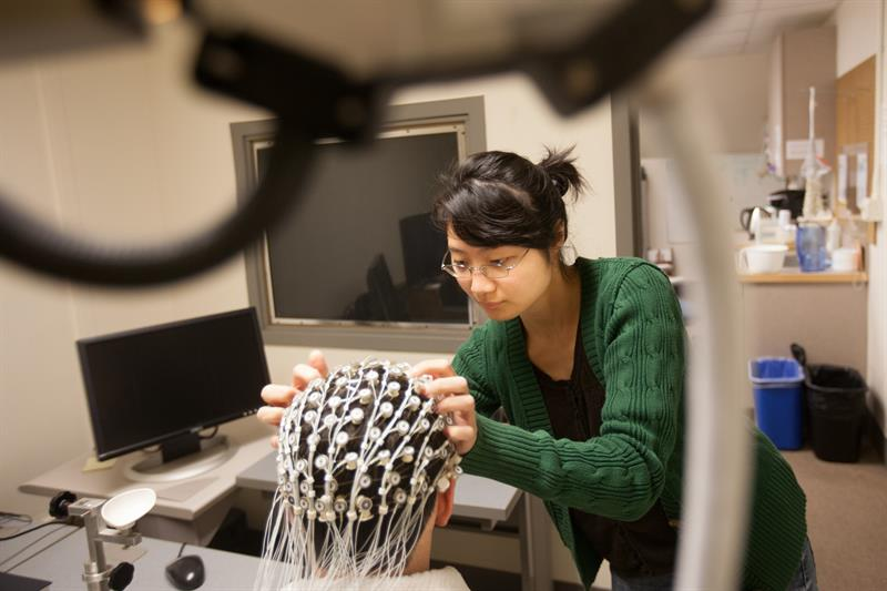 A student works in a brain science lab